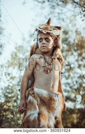Angry Caveman, Manly Boy. Prehistoric Tribal Boy Outdoors On Nature. Young Shaggy And Dirty Savage,
