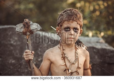 Angry Caveman, Manly Boy With Stone Axe. Prehistoric Tribal Boy Portrait Outdoors On Nature. Young S