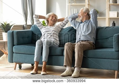 Happy Older Family Relaxing On Cozy Couch At Home