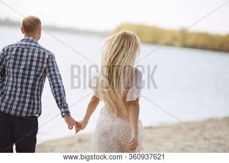 Beautiful Couple In Love On Summer Beach. Outdoor Shot Of Excited Girl And Man Enjoying Weekend At T