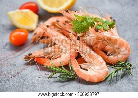 Fresh Shrimp On Dark Plate With Ingredients Herb And Spices / Cooking Seafood Shrimps Prawns Served