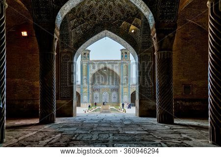 Shiraz, Iran - May 2019: Tourists In Courtyard Of Vakil Mosque As Seen From The Hall Of Prayer. Vaki