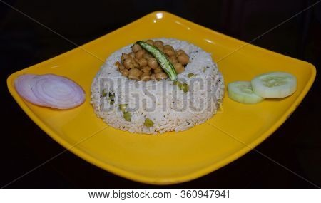 Delicious Indian Dish Chole Chawal (rice With Chickpea Gravy) Along With Vegetable Salad Isolated On
