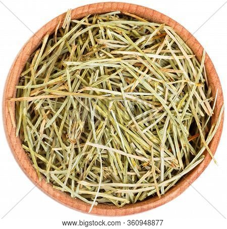 Dried Field Horsetail In A Small Wooden Bow Isolated.