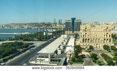 Baku, Azerbaijan - July 2019: Baku Cityscape With Caspian Sea, Flame Towers And Car Traffic