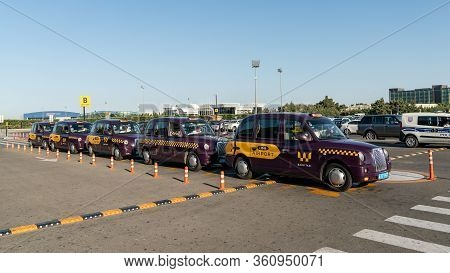 Baku, Azerbaijan - July 2019: Baku Purple Taxis Waiting In Line At Heydar Aliyev Airport, Baku, Azer