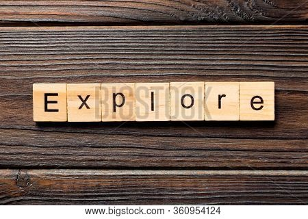 Explore Word Written On Wood Block. Explore Text On Wooden Table For Your Desing, Concept