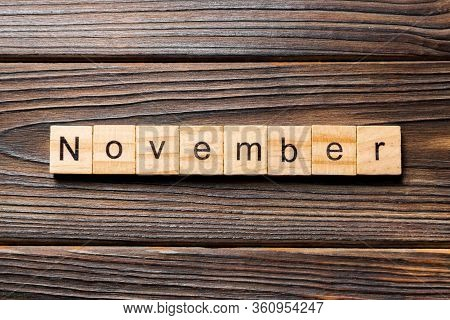 November Word Written On Wood Block. November Text On Wooden Table For Your Desing, Top View Concept