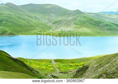 Yamdrok Lake In Himalaya Mountains. Yamdrok Lake Is One Of The Three Holy Lakes In Tibet. Chima
