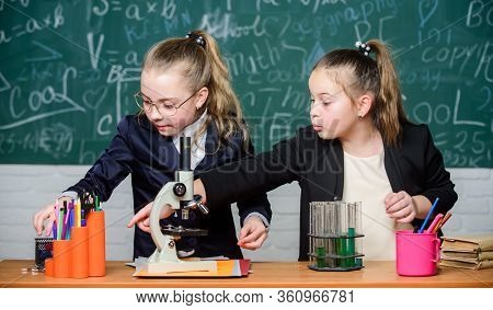 Pupils Cute Girls Use Test Tubes With Liquids. Chemistry Experiment Concept. Safety Measures For Pro