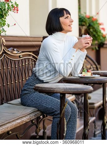 Woman Attractive Elegant Brunette Enjoy Gourmet Coffee Cafe Terrace Background. Pleasant Time And Re