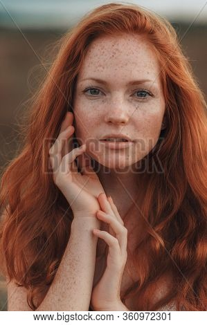 Incredible Young Woman With Long Curly Hair And Freckles Face.