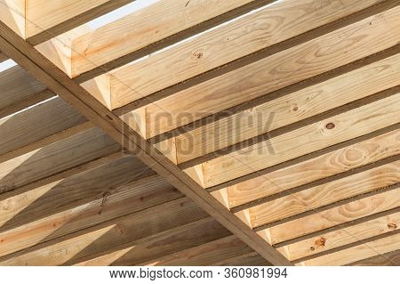Wooden Beams In A Row. Sunshade Ceiling Structure Fragment. Abstract Background Texture