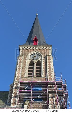 Belgium, Sint Gillis Waas, April 7, 2020 Scaffolding Stand Against The Facade Of The Church