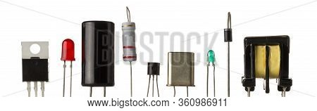 Different Electronic Parts Or Components Isolated On White Background With Resistors, Capacitors, Di