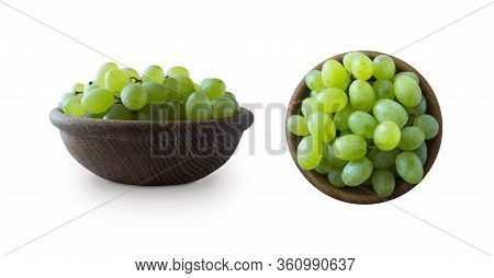 Green Grapes Kishmish Isolated On White. Top View. Grapes In A Wooden Bowl Isolated On White. Green