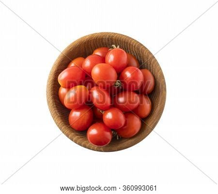 Red Tomatoes Lay On White Background. Top View. Cherry Tomatoes On A Wooden Bowl Isolation. Tomatoes