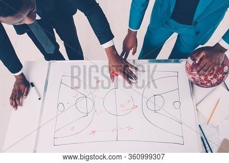 Sport Management. Game Strategy Planning. Two African Basketball Coaches Working On Scheme.