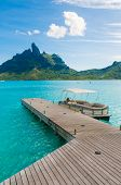 Vertical shot of a deck in the island of Bora bora poster