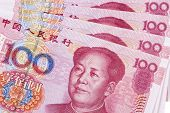 Chinese 100 RMB or Yuan featuring Chairman Mao on the front of each bill poster