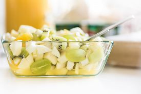Fruit Salad In Glass Bowl - Healthy Lunch Idea - Green Grapes, Banana, Pear, Kiwi Fruit
