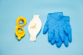 Medical mask, glasses and gloves mask on the background, protection against coronavirus. Respiratory mask and latex gloves and goggles for the face - necessary attributes during the epidemic covid- 19