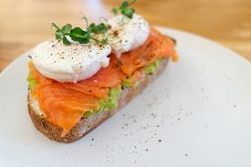 Healthy And Nutritious Food. Sandwich With Fish: Salmon, Coarse-grained Bread, Cream Cheese, Guacomo