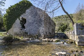 Ruined Ivy Covered House And Pure Spring Water In Early Spring In Blaz Bay, Istria, Croatia