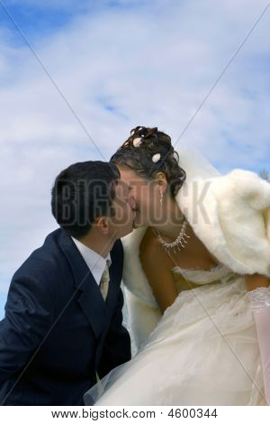 Bride And Groom. Kiss