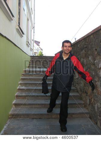 Man Hurriyng Up Downstairs