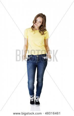 Sad young caucasian teen girl taking out empty pockets, on white.