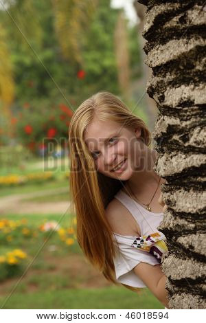 portrait of blonde girl on the nature
