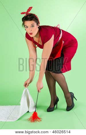Funny pinup girl doing household chores