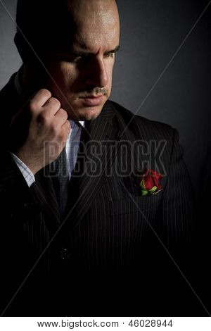 Portrait of man godfather-like character.