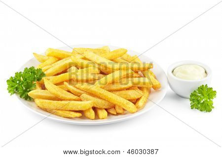 Plate of French fries with a bowl of mayonnaise on white
