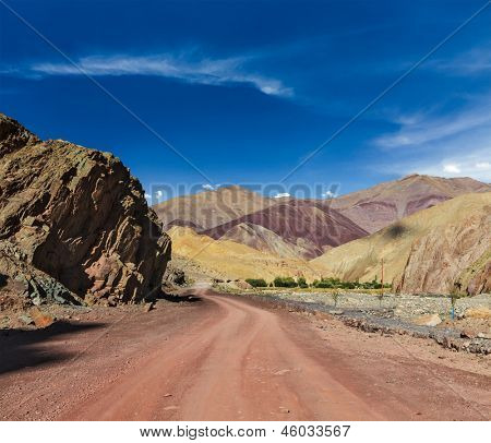 poster of Travel forward concept background - road Himalayas with mountains. Manali-Leh road, Ladakh, Jammu and Kashmir, India