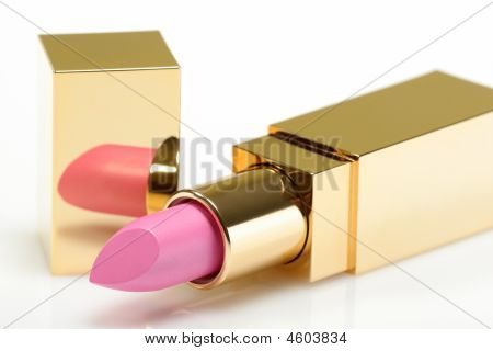 Pink Golden Lipstick On White Background