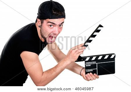man holding a movie clap