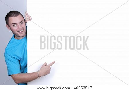 Boy Pointing To A Blank Space Ready For Copy