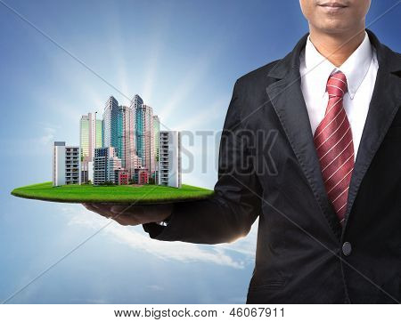 Business Man And Real Estate In Hand