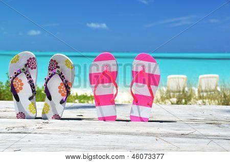 Flip-flops against ocean. Exuma, Bahamas poster