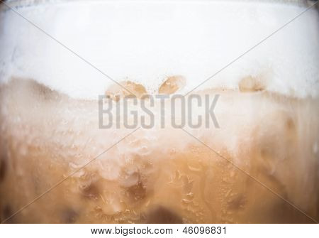 Wave of milk micro foam on frappucino poster