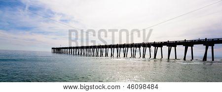 The Pensacola pier with the sun shining through