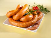 Sausage on a plate and yellow background poster