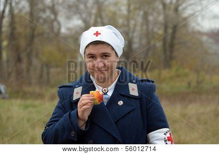 KIEV, UKRAINE -NOV 3 An unidentified members of Red Star history club wears historical German Red Cross (DRK) uniform during historical reenactment of WWII, , November 3, 2013 Kiev, Ukraine