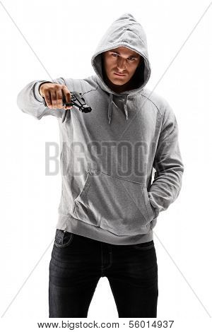Young male with hood over his head holding a gun, symbolizing crime isolated against white background