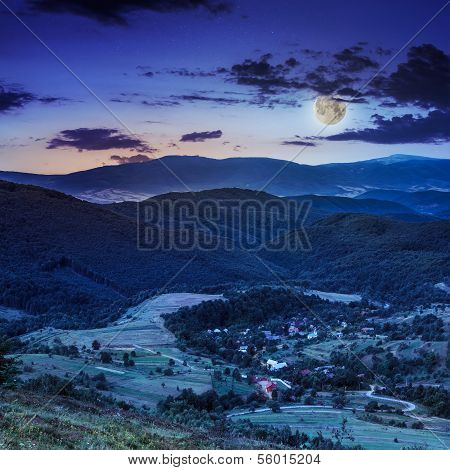Moon Light Falls On Hillside With Autumn Forest In Mountain
