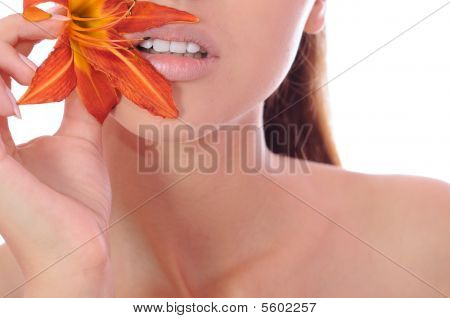 Woman With A Lily In Hands