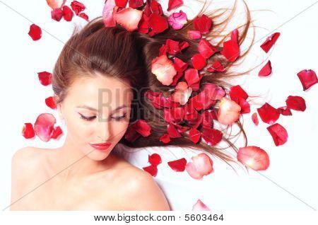 Girl In Petals Of Red Roses