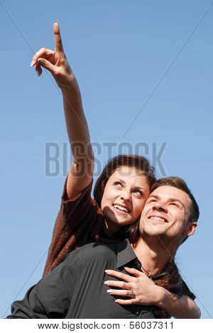 Young Male Giving His Girlfriend Piggyback Ride
